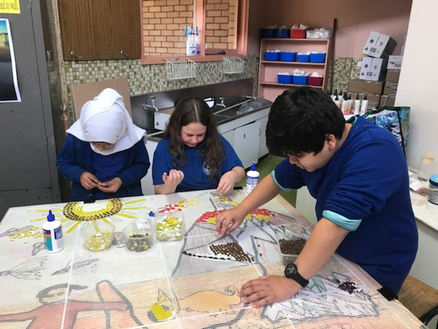 St Georges Primary School students working on Dunggula mural